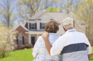 Senior Couple Looking at a Home